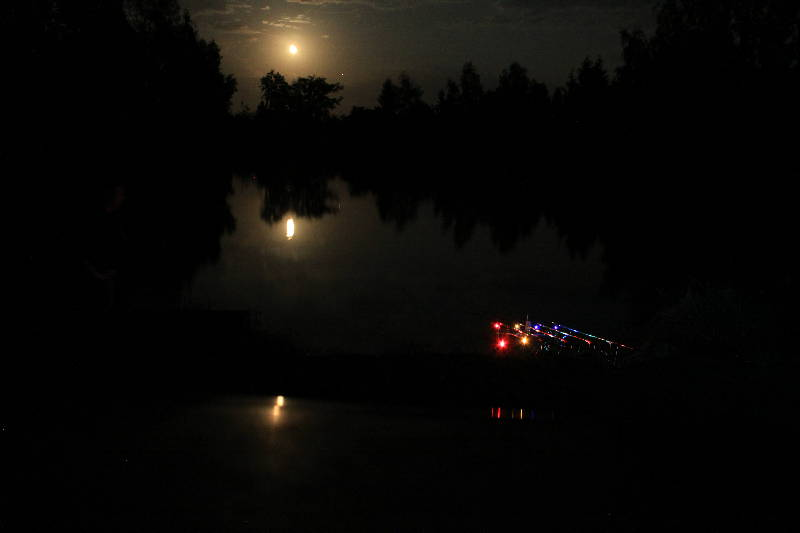 Moon rising over Woodpecker with the buzzers glowing  - Fishing Lakes France